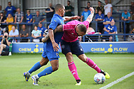 AFC Wimbledon striker Kweshi Appiah (9) battles for possession with Queens Park Rangers defender Joel Lynch (6) during the Pre-Season Friendly match between AFC Wimbledon and Queens Park Rangers at the Cherry Red Records Stadium, Kingston, England on 14 July 2018. Picture by Matthew Redman.