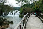 Walkway and bridge near waterfall, Krka National Park, Croatia