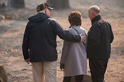 November 17, 2018 - Paradise, California, U.S. - President DONALD TRUMP puts his arm on Paradise Mayor JODY JONES as they tour the Skyway Villa Mobile Home and RV Park with Gov. JERRY BROWN (R) during his visit of the Camp Fire in Paradise. The Camp Fire in Northern California has become the nations deadliest wildfire in a century and has killed at least 63 people and left more than 1000 still missing. (Credit Image: © Paul Kitagaki Jr./ZUMA Wire)