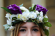 A woman wears roses in the colours of the suffrage movement in her hair at the Bread and Roses Womens March on January 19, 2019 in London, England.  The event was dubbed the Bread and Roses March based on the strikes of the same name by textile workers in Massachusetts in 1912 and Bread and Roses is the title of a poem by American poet James Oppenheim about the strikes.