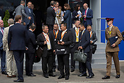 Accompanied by British military personnel, potential customers leave the Thales exhibition and hospitality chalet at the Farnborough Airshow, on 16th July 2018, in Farnborough, England.