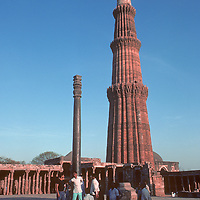 Qutab Minar, in Delhi, India, is the world' tallest freestanding brick and rock minaret. It stands 72 meters and was built by India's first Islamic rulers between 1193 & 1386. It and contemporaneous surrounding structures are all part of the Qutab complex, a UNESCO world heritage site. In the foreground is the mysterious Iron Pillar where,  according to the traditional belief, any one who can encircle the column with their arms, facing backwards, can have a wish granted.