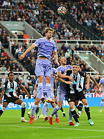 NEWCASTLE UPON TYNE, ENGLAND - SEPTEMBER 17: Patrick Bamford of Leeds United headers a Newcastle corner clear during the Premier League match between Newcastle United and Leeds United at St. James Park on September 17, 2021 in Newcastle upon Tyne, England. (Photo by MB Media)
