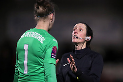 Referee Amy Fearn (right) speaks with Arsenal goalkeeper Sari Van Veenendaal