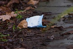 © Licensed to London News Pictures. 20/01/2021. London, UK. A covid-19 face mask lies on the path of a property at West Park in Greenwich, south east London where a man was found fatally stabbed yesterday. Police were called on Tuesday at 12:25 hrs and a 74-year-old man was found suffering from a knife injury, he was pronounced dead at the scene. A 23-year-old male was arrested at the property on suspicion of murder. The deceased and the suspect were known to each other. Photo credit: Peter Macdiarmid/LNP