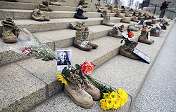 April 12, 2018 - St. Paul, MN, USA - For the fourth year in a row,  20 sets of boots have been placed on the steps of the Minnesota capitol every day for 5 days until 100 sets are displayed representing 20 members of the military lost to suicide every day in the USA.  The foreground boots are a memorial to Nicole A.  Burnham of Andover ] ..BRIAN PETERSON • brian.peterson@startribune.com..St. Paul, MN  04/12/2018. (Credit Image: © Brian Peterson/Minneapolis Star Tribune via ZUMA Wire)