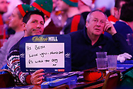 Member of the crowd with a message to his daughter during the PDC World Championship darts at Alexandra Palace, London, United Kingdom on 14 December 2018.