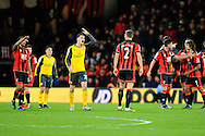 Granit Xhaka (29) of Arsenal goes to confront AFC Bournemouth defender Simon Francis as he is taking to long to leave the field after being shown a red card and sent off during the Premier League match between Bournemouth and Arsenal at the Vitality Stadium, Bournemouth, England on 3 January 2017. Photo by Graham Hunt.