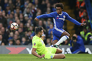 Ryan Tafazolli of Peterborough United tackles Willian of Chelsea. The Emirates FA cup, 3rd round match, Chelsea v Peterborough Utd at Stamford Bridge in London on Sunday 8th January 2017.<br /> pic by John Patrick Fletcher, Andrew Orchard sports photography.