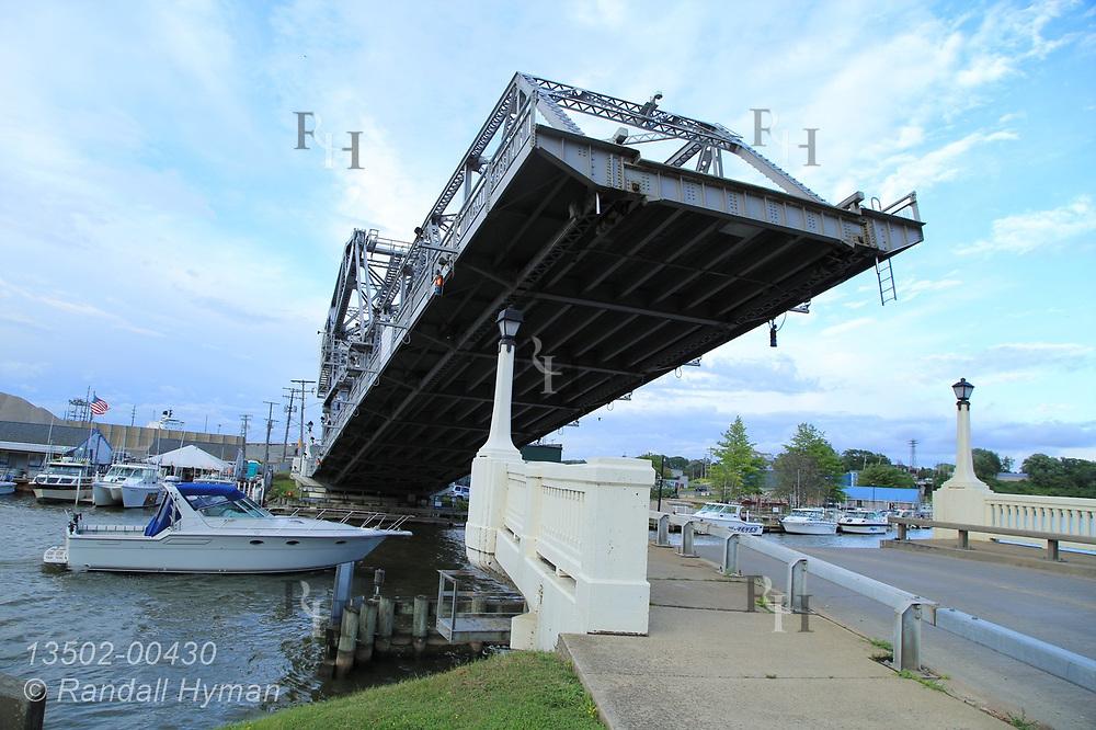 Yacht passes beneath draw bridge near mouth of Ashtabula River in downtown Ashtabula, Ohio.