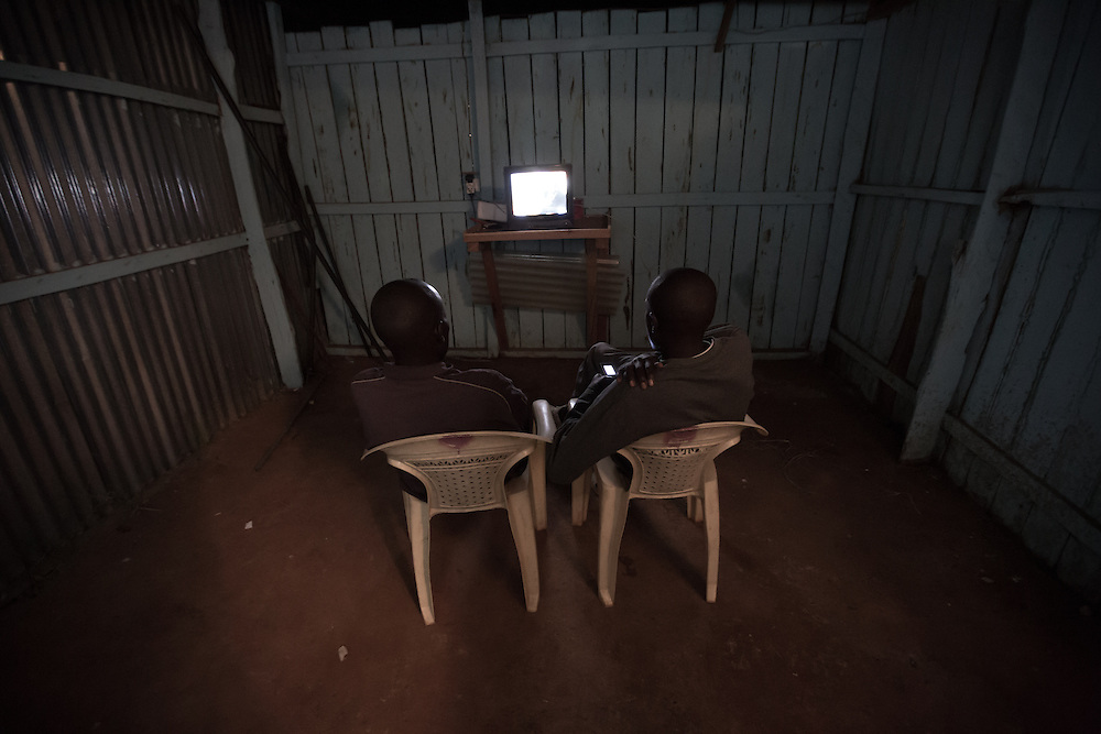 Athletes enjoy some post-dinner television at the Run-Fast Academy in Iten, Kenya, a training camp for Kenyan runners.