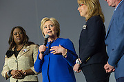 Democratic presidential candidate Hillary Rodham Clinton thanks former Congresswoman Gabby Giffords and other participants following the Breaking Down Barriers Forum on gun violence at Central Baptist Church February 23, 2016 in Columbia, South Carolina. The event was attended by mothers who lost their children to gun violence and police incidents.