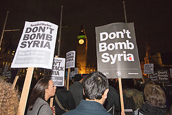 "Westminster, London, December 1st 2015.  As Parliament debates air strikes on Islamic State terrorists in Syria, an ""emergency protest"" is held by Stop The War and other groups opposed to British military involvement. PICTURED: ///FOR LICENCING CONTACT: paul@pauldaveycreative.co.uk TEL:+44 (0) 7966 016 296 or +44 (0) 20 8969 6875. ©2015 Paul R Davey. All rights reserved."