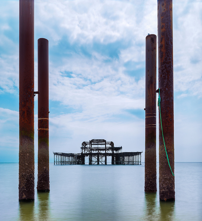Editions of 17<br /> Remains of an old Victorian Pier sit forlornly just off Brighton's seafront