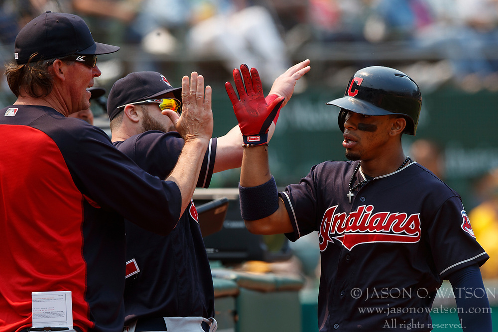 OAKLAND, CA - JULY 01: Francisco Lindor #12 of the Cleveland Indians is congratulated by teammates after hitting a home run against the Oakland Athletics during the seventh inning at the Oakland Coliseum on July 1, 2018 in Oakland, California. The Cleveland Indians defeated the Oakland Athletics 15-3. (Photo by Jason O. Watson/Getty Images) *** Local Caption *** Francisco Lindor