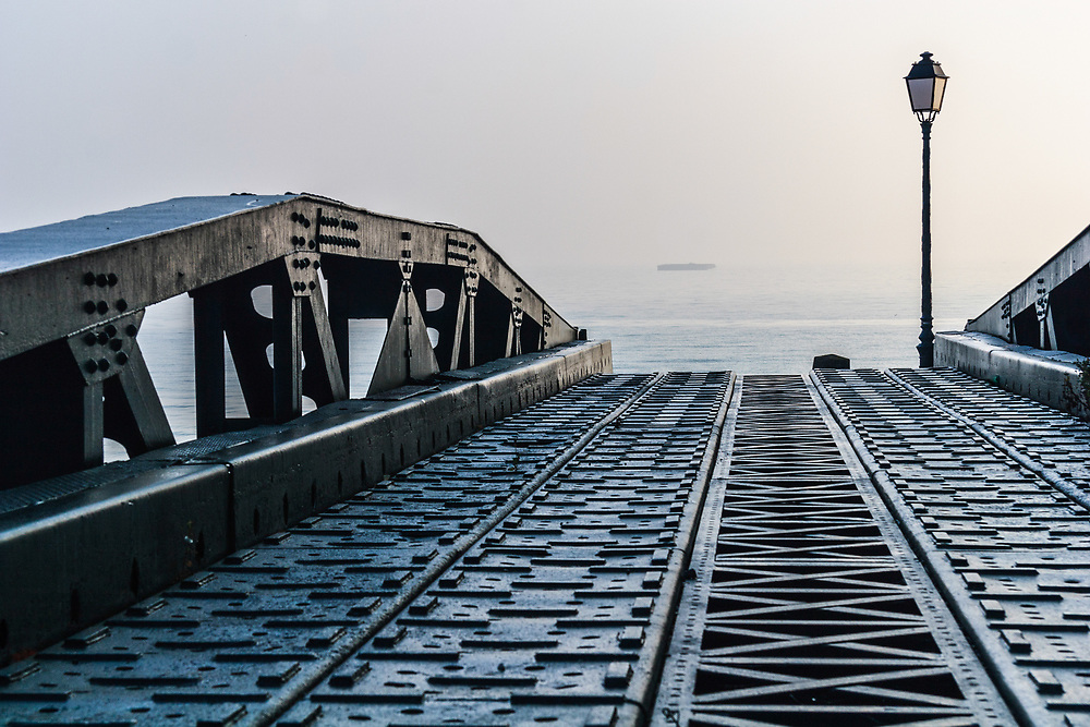 A Mulberry Harbour bridging unit in Arromanches, France. Pioneers made the roadways that connected the piers to the land from torsionally flexible bridging units that had a span of 80 ft.