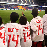 Young Thierry Henry fans watch the New York Red Bulls warming up during the New York Red Bulls V Toronto FC  Major League Soccer regular season match at Red Bull Arena, Harrison. New Jersey. USA. 29th September 2012. Photo Tim Clayton