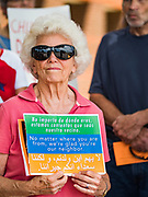 02 JULY 2019 - DES MOINES, IOWA: A woman stands in front of Rep. Cindy Axne's (D-IA) office in Des Moines during. About 150 people came to Congresswoman Axne's office Tuesday to protest the treatment of migrant children detained by the US Border Patrol along the US/Mexico border. Axne was not in the office, but a member of Axne's staff took notes and promised to pass people's concerns on to the Congresswoman. Similar protests were held at other congressional offices and Immigration and Customs Enforcement (ICE) detention facilities across the country.          PHOTO BY JACK KURTZ