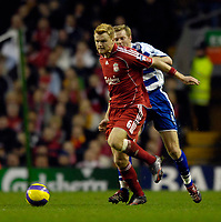 Photo: Jed Wee.<br />Liverpool v Reading. The Barclays Premiership. 04/11/2006.<br /><br />Liverpool's John Arne Riise (L) breaks clear of Reading's Bryn Gunnarsson.