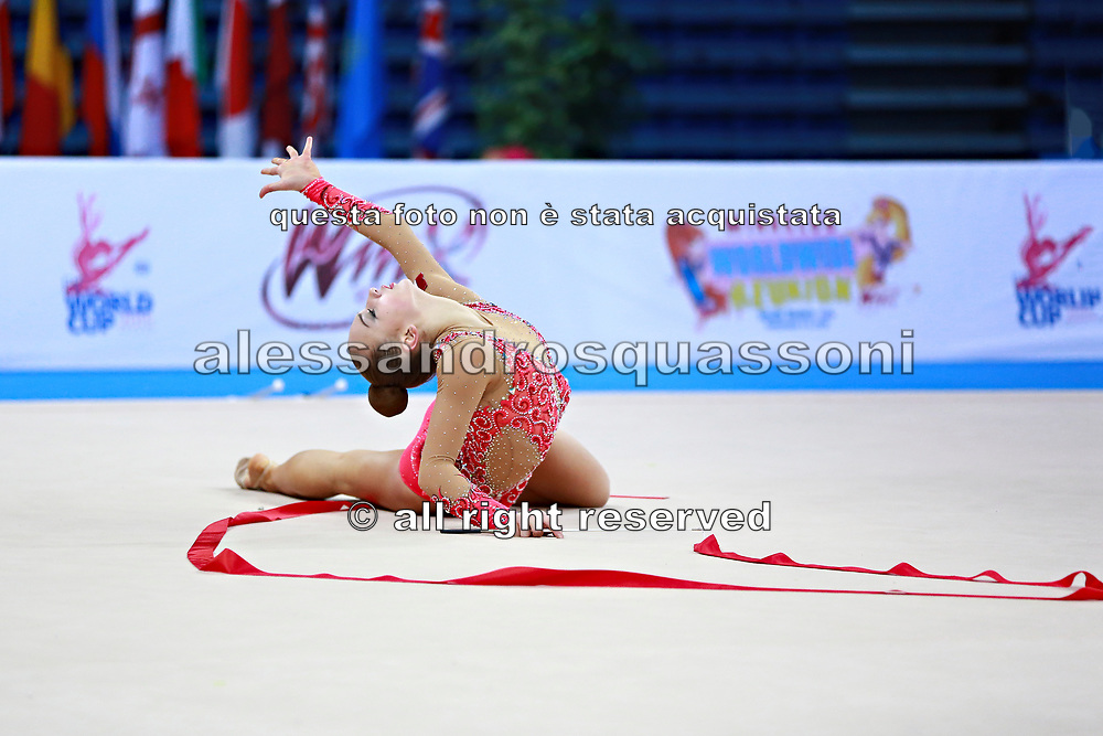 Bezzoubenko Patricia during qualifying at ribbon in Pesaro World Cup 11 April 2015.<br /> Patricia was born on 21 February, 1997 a retired individual Canadian rhythmic gymnast.