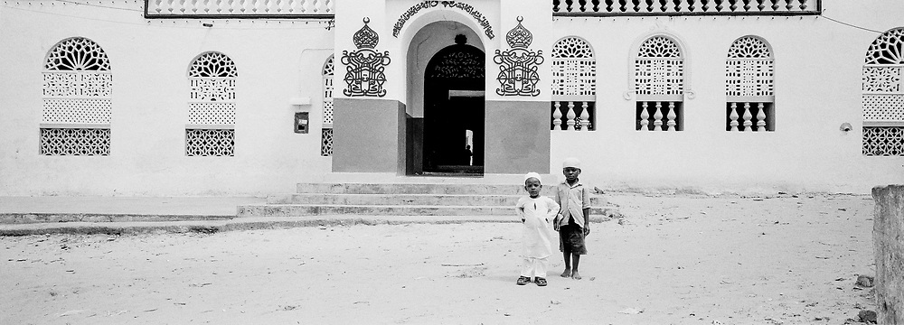 Boys in front of temple, Island of Lamu, Kenya, July, 2002