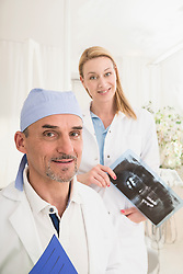 Portrait of male dentist with dental assistant, Munich, Bavaria, Germany