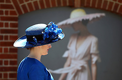 A female racegoer arrives for day four of Royal Ascot at Ascot Racecourse.