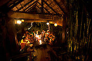 Family dinner for Menzel/D'Aluisios at Dyen Sabai Restaurant on the Nam Khan River, Luang Prabang, Laos.