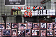 As the third national coronavirus lockdown continues, shops remain closed with shutters down and many shops like this gents hairdresser small business in Balsall Heath have had to close altogether and now the premises are to let on 18th January 2021 in Birmingham, United Kingdom. Following the recent surge in cases including the new variant of Covid-19, this nationwide lockdown, which is an effective Tier Five, advises all citizens to follow the message to stay at home, protect the NHS and save lives.