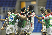 Reading, GREAT BRITAIN,   Left Justin BISHOP and Justin HARRISON disagree about a incident of the ball , during the third round Heineken Cup game, London Irish vs Ulster Rugby, at the Madejski Stadium, Reading ENGLAND, Sat., <br /> 09.12.2006. [Photo Peter Spurrier/Intersport Images]