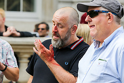 "© Licensed to London News Pictures. 07/09/2019. London, UK. A Pro Brexit protester is seen bleeding as he was by the confronted police officers in Whitehall as anti-Brexit protesters take part in ""Defend our Democracy and Stop Brexit"" demonstration in Whitehall, Westminster. The protesters are demonstrating against the British Prime Minister Boris Johnson's intention to prorogue Parliament until 14 October. Photo credit: Dinendra Haria/LNP"