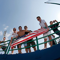 27 September 2009: Fans hold USA national flag prior to the 2009 Baseball World Cup gold medal game won 10-5 by Team USA over Cuba, in Nettuno, Italy.
