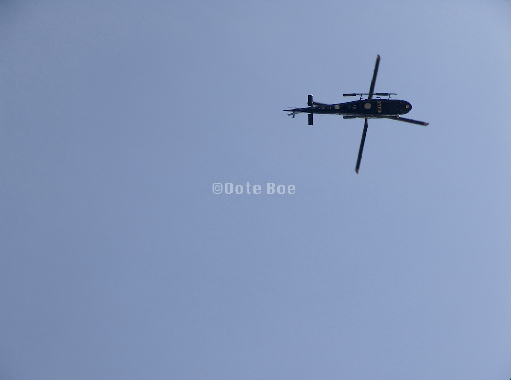 silhouette of NYPD helicopter