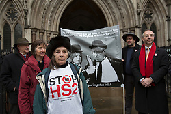 © licensed to London News Pictures. London, UK 03/12/2012. Protester against HS2 standing outside Royal Courts of Justice as groups challenge the Government's decision to go ahead with a proposed high speed rail link between London and the north of England. Photo credit: Tolga Akmen/LNP