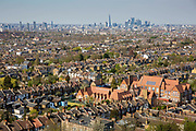 Londons skyline from Dawson's Heights in Dulwich, London, England, United Kingdom. Residential homes on streets of terraced housing and in the distance skyscrapers rise in central London and the City of London.