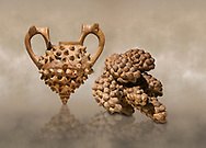 Hittite terra cotta two handled vessel and a ritual vessel in the shape of a bunch of grapes - 16th century BC - Hattusa ( Bogazkoy ) - Museum of Anatolian Civilisations, Ankara, Turkey .<br /> <br /> If you prefer to buy from our ALAMY STOCK LIBRARY page at https://www.alamy.com/portfolio/paul-williams-funkystock/hittite-art-antiquities.html  - Type Hattusa into the LOWER SEARCH WITHIN GALLERY box. Refine search by adding background colour, place, museum etc<br /> <br /> Visit our HITTITE PHOTO COLLECTIONS for more photos to download or buy as wall art prints https://funkystock.photoshelter.com/gallery-collection/The-Hittites-Art-Artefacts-Antiquities-Historic-Sites-Pictures-Images-of/C0000NUBSMhSc3Oo