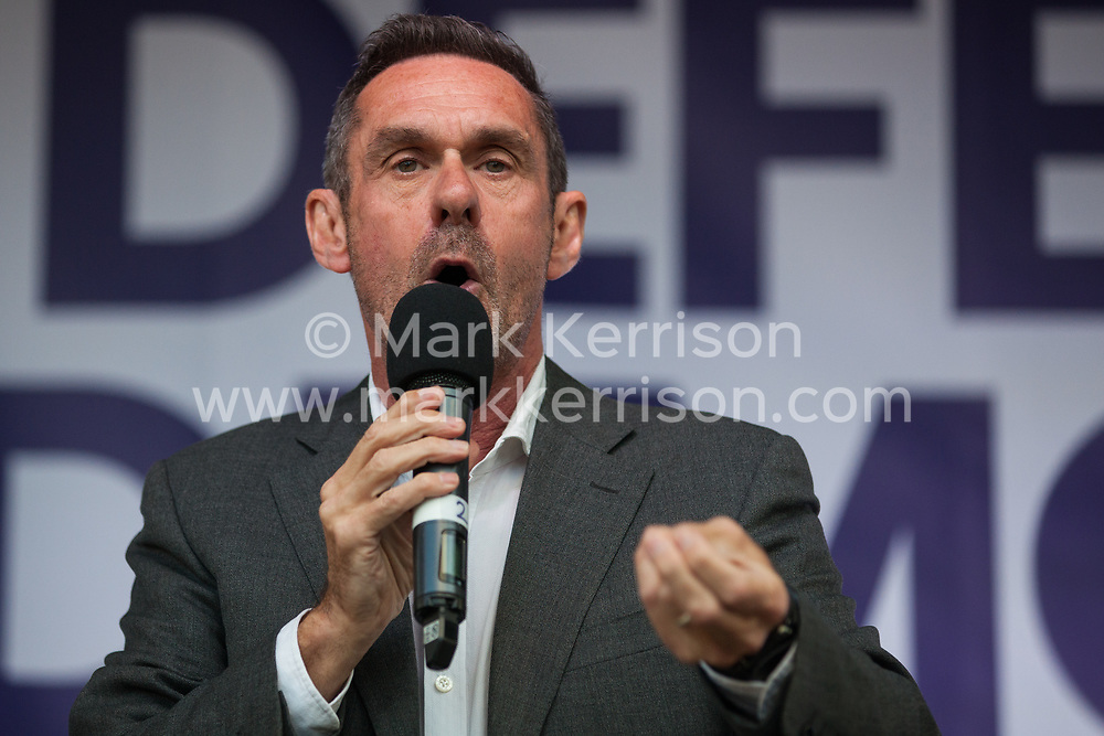 London, UK. 4 September, 2019. Journalist Paul Mason addresses Remain supporters at a Defend Our Democracy rally in Parliament Square shortly after MPs passed the Brexit delay bill in the House of Commons.