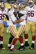San Francisco 49ers quarterback Christian Ponder (5) celebrates with San Francisco 49ers running back Kelvin Taylor (23) after running for a one yard touchdown that cuts the San Diego Chargers fourth quarter lead to 21-16 during the 2016 NFL preseason football game against the San Diego Chargers on Thursday, Sept. 1, 2016 in San Diego. The 49ers won the game 31-21. (©Paul Anthony Spinelli)