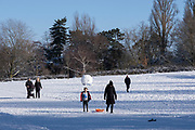 People in a winter scene in the snow in Canon Hill Park in Moor Green on 25th January 2021 in Birmingham, United Kingdom. Deep snow arrived in the Midlands giving some light relief and fun during the current lockdown for people who simply enjoyed the weather.