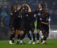 Photo: Paul Greenwood.<br />Bolton Wanderers v Portsmouth. The Barclays Premiership. 30/12/2006. Portsmouth players mob goalscorer Matthew Taylor (unseen)
