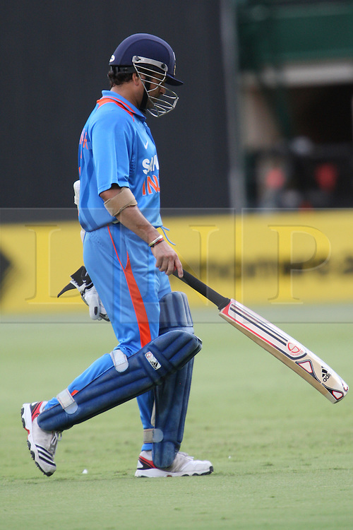 © Licensed to London News Pictures. 14/02/2012. Adelaide Oval, Australia. Sachin Tendulkar walks off after getting out for 15 runs during the One Day International cricket match between India Vs Sri Lanka. Photo credit : Asanka Brendon Ratnayake/LNP