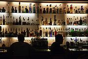 Shelves of bottles in bar