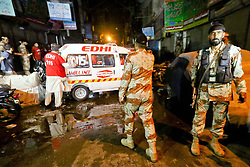 April 25, 2017 - Pakistan - Law and enforcement officials cordon off the site after hours-.long fire exchange between militants and the paramilitary forces in raid a residential building of .Urdu Bazar area of Karachi on Tuesday. Four terrorists, including a woman, .were killed and four paramilitary personnel injured in an hours-long gunfight between Rangers .and militants holed up inside a residential building in the Karachi's Urdu Bazar vicinity late .Monday. In fresh raids on Tuesday, law enforcers detained abettors of the terrorists as .well. (Credit Image: © PPI via ZUMA Wire)