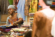 Vendor selling textiles at the 22nd Salon International de l'Artisanat de Ouagadougou (SIAO) in Ouagadougou, Burkina Faso on Sunday November 2, 2008.