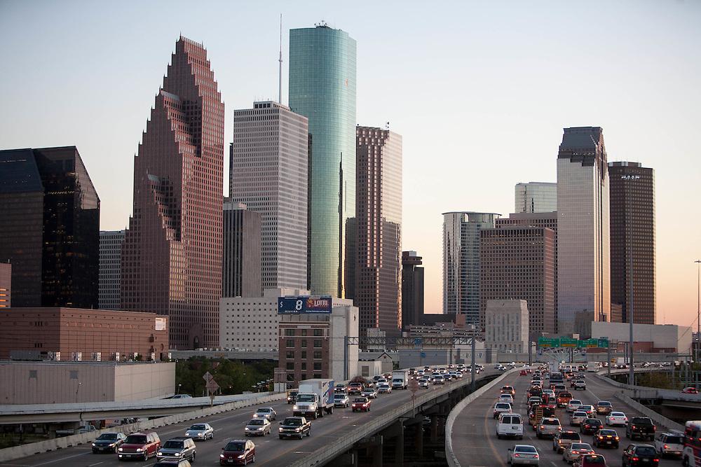 Northwest side of the Houston, Texas skyline with rush hour commuter traffic on I-45 freeway at dusk.