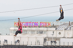 © Licensed to London News Pictures. 18/02/2018. Brighton, UK. Members of the public take a ride on the Brighton and Hove beachfront Zip Wire attraction as dry and milder weather in hitting the seaside resort. Photo credit: Hugo Michiels/LNP