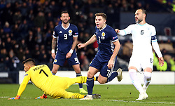 Scotland's James Forrest (centre) celebrates scoring his side's third goal of the game and completing his hat-trick during the UEFA Nations League, Group C1 match at Hampden Park, Glasgow.