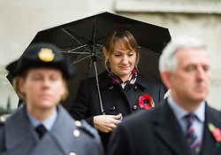 © Licensed to London News Pictures. 04/11/2015. London, UK. An emotional woman crying during the service. Service to mark the opening of the Filed of Remembrance at Westminster Abbey, attended by Prince Philip, Duke of Edinburgh and Prince Harry.  The Field of remembrance is a memorial garden to commemorate British and Commonwealth military and civilian servicemen and women in the two World Wars and later conflicts. Photo credit: Ben Cawthra/LNP