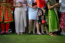 Guests during a garden party at Buckingham Palace in London.