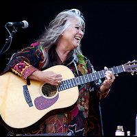 Melanie safka - 40years on at the 2010 Isle of Wight Festival.- .Charles received a press pass by kind permission of John Giddings, promoter of the 2010 Isle of Wight festival, primarily to capture Melanie's return, 40 years on.  .However at 81, and sporting a digital camera for the first time he was to be found alongside the next generation of his family photographically documenting the event. The images will be added to the growing CameronLife photo library (an on-going project to digitise, conserve and promote Charles' work, which his family will build upon)